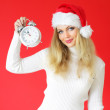 Santa girl on a red background — Stock Photo #3898517