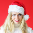Santa girl on a red background — Stock Photo #3907134