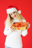 Santa girl on a red background — Stock Photo