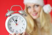 Girl holding an alarm clock — Stock Photo