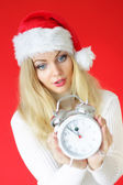 Surprised woman looking at clock — Stock Photo
