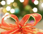 červená stužka na pozadí světla — Stock fotografie