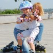 Family rollerblading — Stock Photo