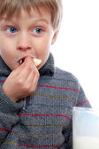 Boy eating bread — Stock Photo