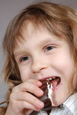 Girl eating a sweet — Stock Photo