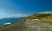 Unrecognizible on the Black Sea beach — Stock Photo