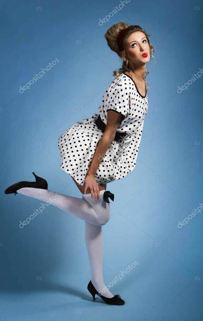 Young pretty woman pinup portrait against blue background — Stock Photo #3437171