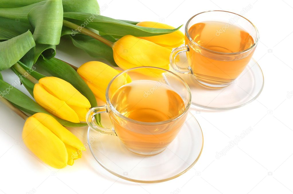 Class cups with green tea and colored tulips on white background — Stock Photo #2739237