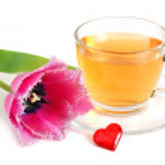 Tea and tulips — Stock Photo