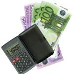 Calculator with Euro bank notes — Stock Photo