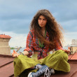 Girl on a roof — Stock Photo