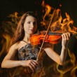 Royalty-Free Stock Photo: Violinist in flame