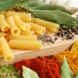 Macaroni with bay leaves and spice — Stock Photo