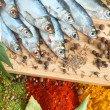 Stock Photo: Fish with bay leaves and spice