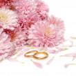 Wedding rings with flowers — Stock Photo #3224382