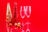 Christmas trees and champagne — Stock Photo