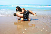 Teens on the beach — Stock Photo