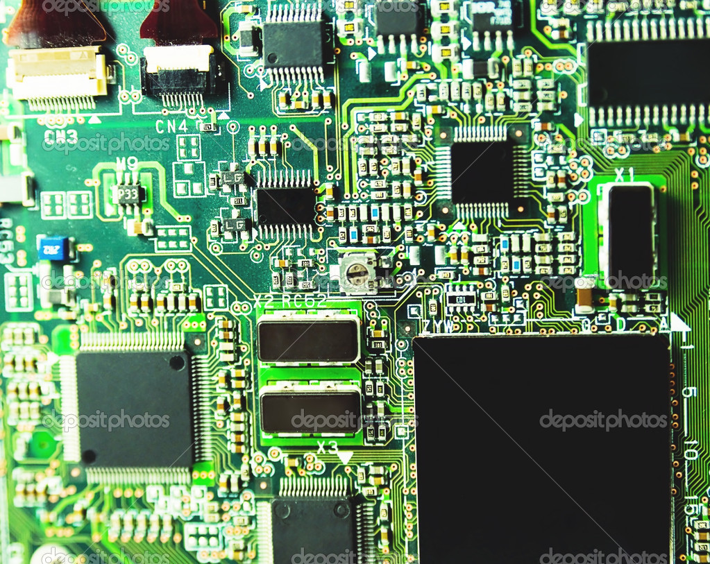 Shallow depth-of-field image of green computer circuit board — Stock Photo #3429513