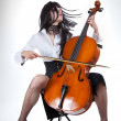 Sensual girl playing cello and moving her hair - Stock Photo