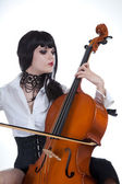 Attractive girl playing cello — Stock Photo