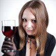 Sensual woman with glass of wine — Stock Photo