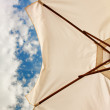 Low angle view of white beach umbrella — Stock Photo