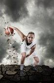 Basketball player running on grungy surface — Stock Photo