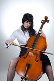 Young woman playing cello — Stock Photo