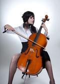 Romantic girl playing cello — Stock Photo