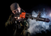 Young soldier in uniform with rifle — Stock Photo