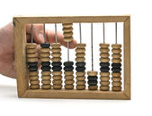 Calculation on wooden accounts — Stock Photo
