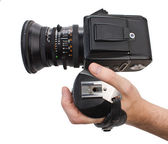 Hand holds the handle of the camera — Stock Photo
