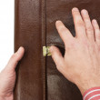 Hand lock buttons on briefcase — Stock Photo #3189376