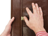 Hand lock buttons on the briefcase — Stock Photo