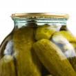 Glass jar of preserved gherkins — Stock Photo