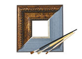 Frame for pictures and brush — Stock Photo