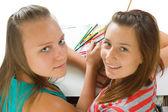 Two teenage girls paint — Stock Photo