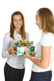 Young girls and a box with a gift — 图库照片