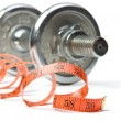 Dumbbell and measuring tape — Stock Photo
