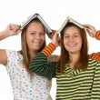 Foto Stock: Two teenage girls fool around