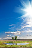 Lake and sky with sun — Stock Photo