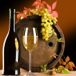 Still life of wine barrel glass grape — Stockfoto