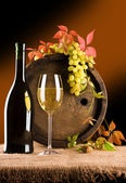 Still life of wine barrel glass grape — Stock Photo