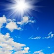 Cloudy blue sky and sun — Stock Photo #3705402