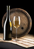 Composition of white wine and bottle on a background of old wine — Stock Photo
