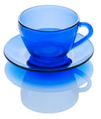 Blue cup on the sauser isolated — Stock Photo
