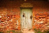 Old brick wall with door — Stock Photo