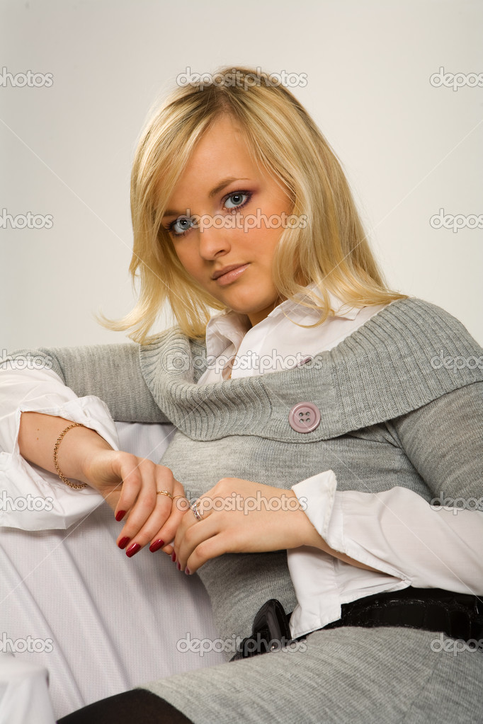 Portrait of the young girl on a gray backgound  Stock Photo #3705967