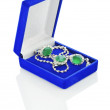 Silver jewelry in dark-blue box isolated — 图库照片