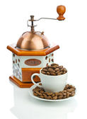 Composition of manual coffee grinder and cup with beans — Stock Photo